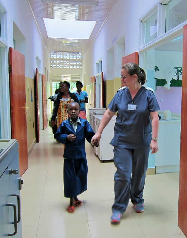 The first of the patients being taken into their new wards